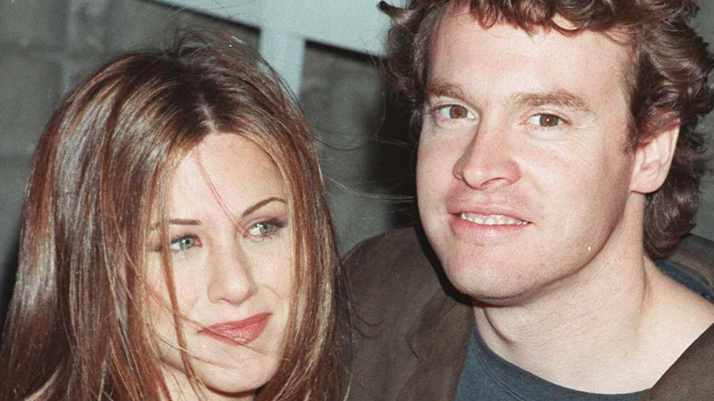 ジェニファー・アニストンとテイト・ドノヴァンの笑顔